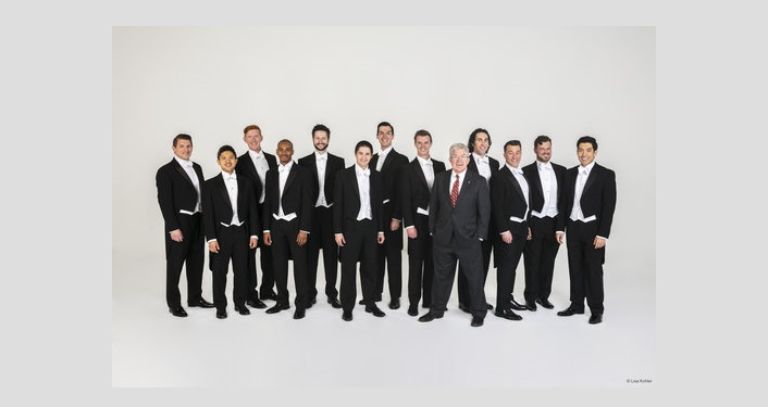 press photo of Chanticleer, acapella men's chorale; 13 men wearing black tuxedos with tails, white shirts