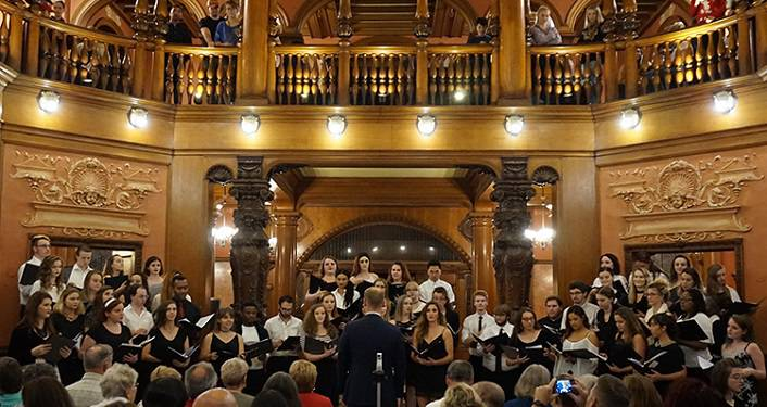 image of college aged men and women in choir singing, Flagler College Holiday Choir