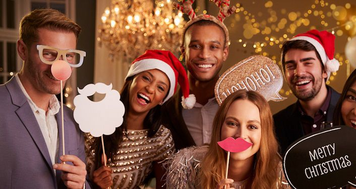image of three men, two women dressed in formal holiday attire, two wearing Santa hat, two with Santa beard on stick for Hennessy Holiday Ball