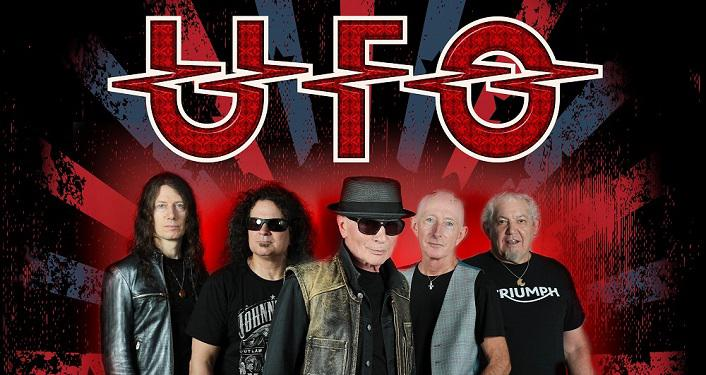 Big red letters, UFO; five older men, two bald, three with long hair. All wearing black shirts