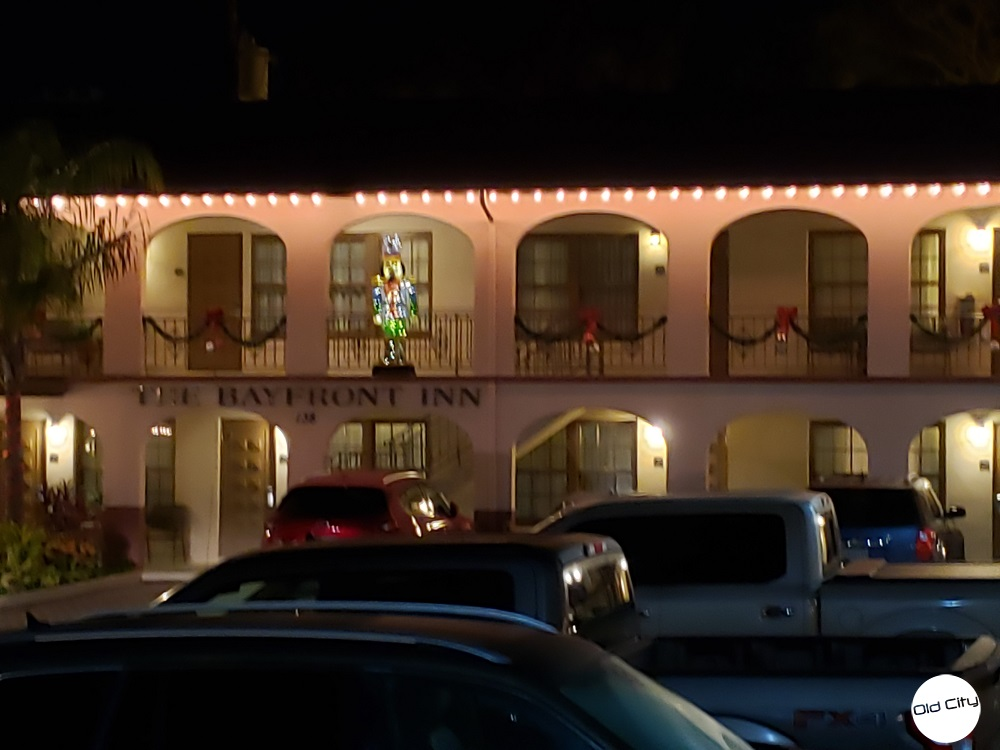 Image contains two floors of hotel rooms and holiday lights.