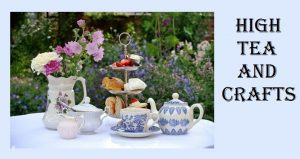 photo of tea pot, cup and saucer, sugar bowl and creamer and pasteries on a table outside with flowers in the background; High Tea and Crafts