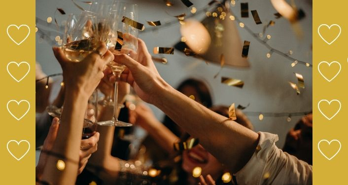 Image contains a group of people's hands holding champagne glasses making a toast.