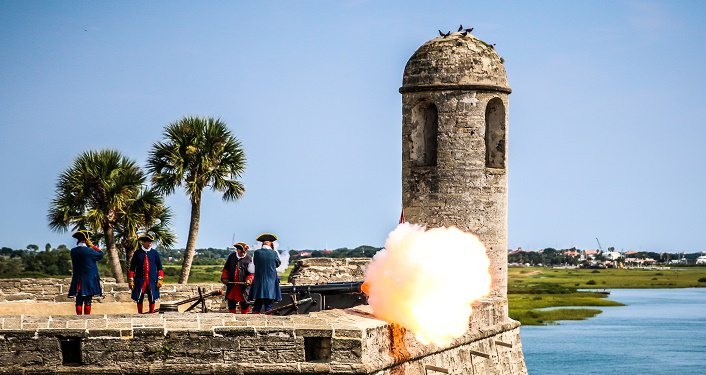 image of re-enactors firing cannon at the Castillo de San Marcos during Historic Weapons Demonstration