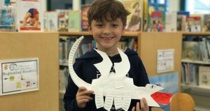 St. Johns County Public Library Event; young boy holding a paper dragon
