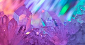 image of crystals with shades of pinks and purples reflected. Crystals & Meditation Online Workshop