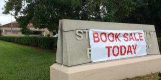 Exterior Book Sale Sign donated by Chris McDevitt; produced by Signs by Darrel Galles