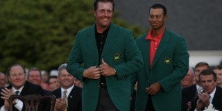UNITED STATES - APRIL 09:  Golf: The Masters, Phil Mickelson victorious, putting on green blazer with Tiger Woods after winning tournament on Sunday at Augusta National, Augusta, GA 4/9/2006  (Photo by Robert Beck/Sports Illustrated/Getty Images)  (SetNumber: X75645 TK4 R14)